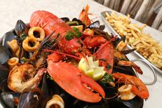 "Porto Mar Carte Restaurant Frontignan qui propose des fruits de mer chauds ici le ""grill de la mer"" (® SAAM-fabrice Chort)"